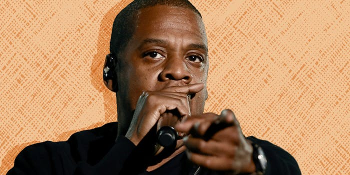 Jay-Z performing and pointing to the camera