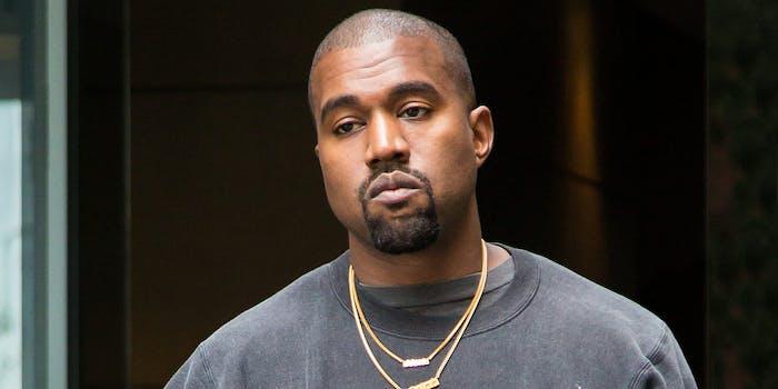 Kanye West leaving hotel