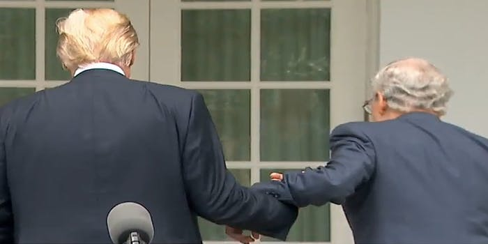 Donald Trump and Mitch McConnell holding hands
