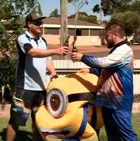 minion and friend share beer