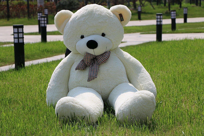 stuffed bear on grass