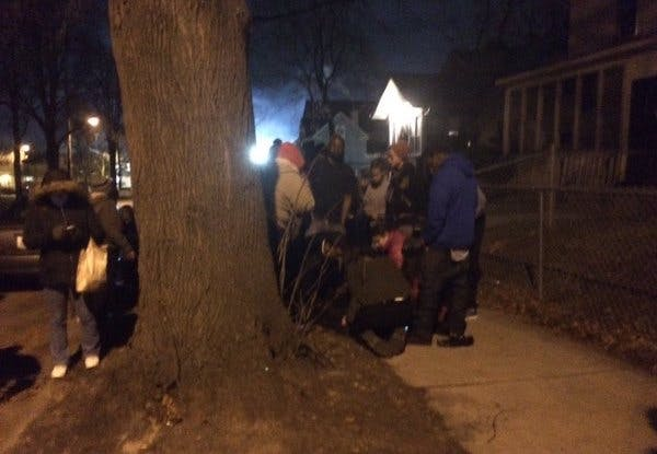 Black Lives Matter protesters huddled around one of the victims. —