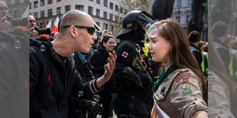 A Czech scout stands firm as a neo-Nazi talks at her during a demonstration in Brno, Czech Republic.