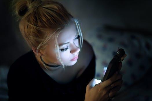 woman in dark on phone