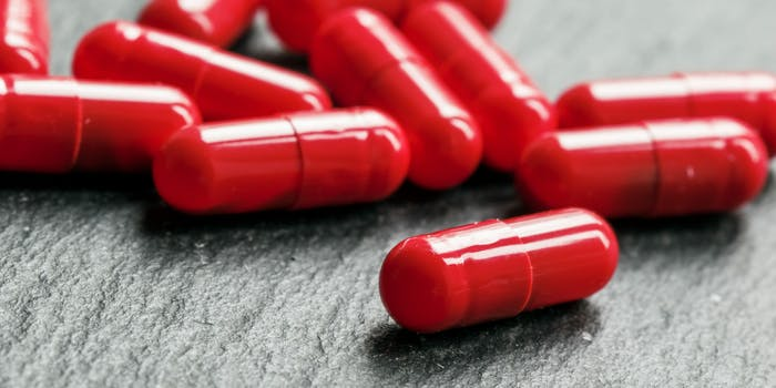 Scattered red pill capsules.