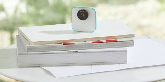 Google Clips sitting atop books