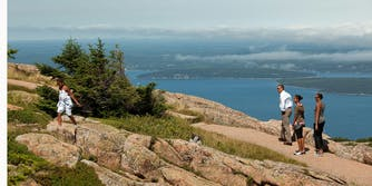 President Barack Obama and his family hike on Cadillac Mountain at Acadia National Park in Maine, July 16, 2010. Photo by Pete Souza.