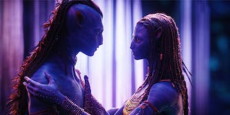 Avatar Na'vi holding one another
