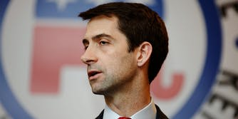 Tom Cotton in front of GOP logo