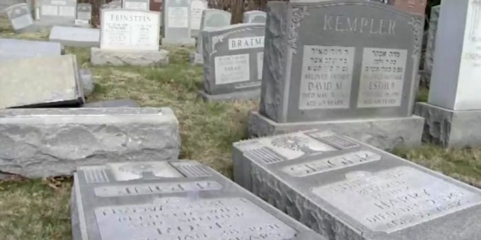 Vandalized grave markers in a Jewish cemetery.