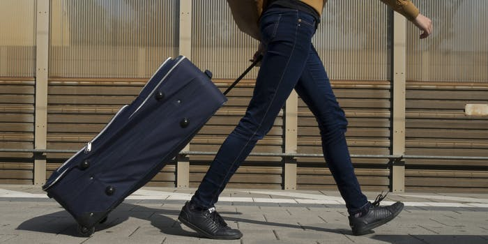couchsurfing : Woman walking on train platform with luggage