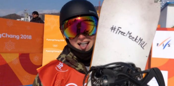 Tit Stante holds up a snowboard with #FreeMeekMill written on it in Sharpie