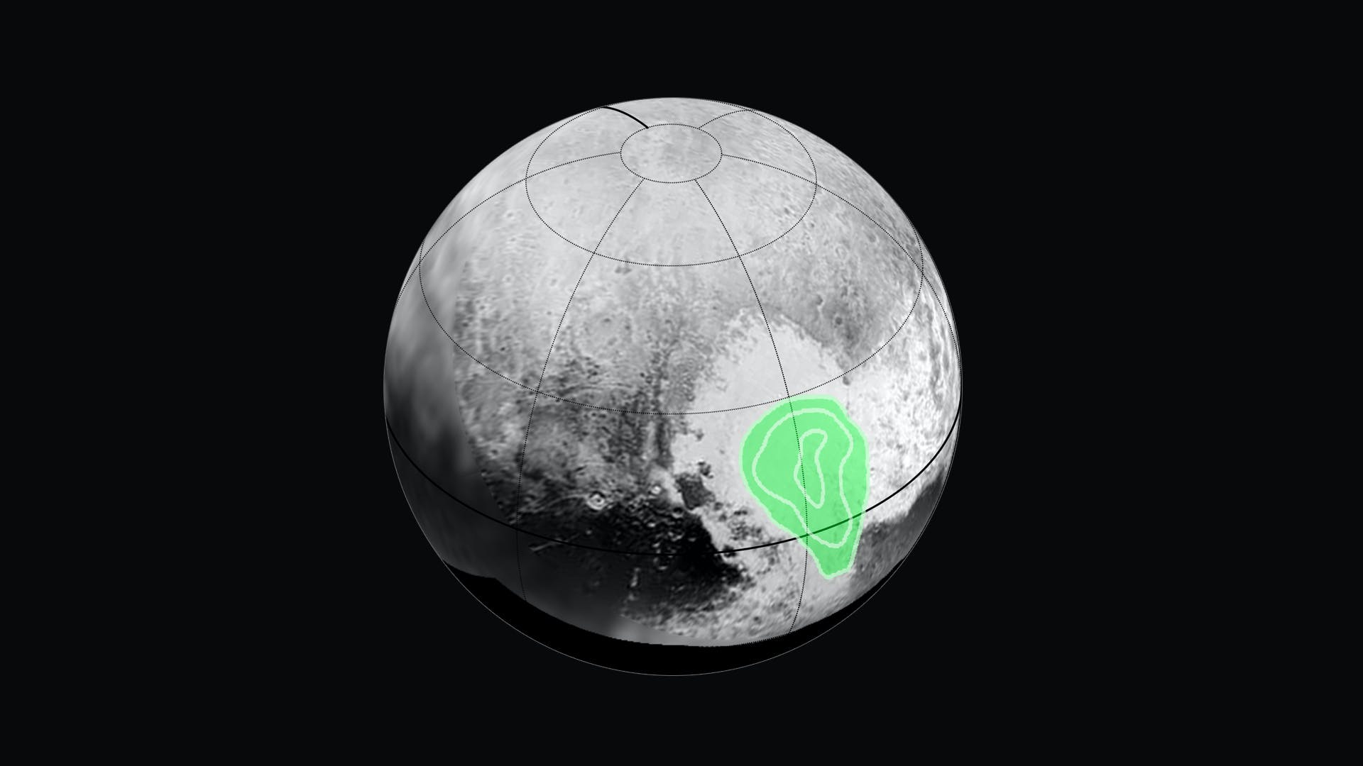 """NASA shows frozen carbon monoxide layer in Pluto's """"heart"""" highlighted in green."""