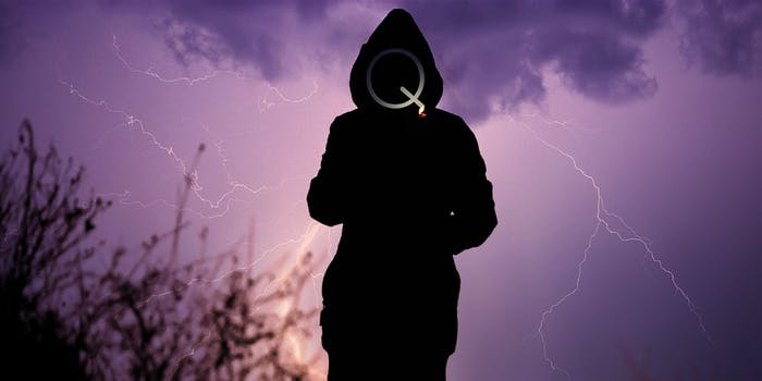 Silhouette of person lighting cigarette in front of lightning storm, face made of the letter Q