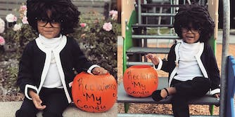"""Young girl dressed as Maxine Waters for Halloween, with """"Reclaiming my candy"""" written on her pumpkin bucket"""