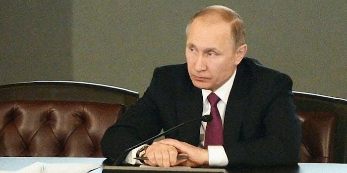 Vladimir Putin sitting at desk