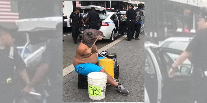 Man in T-Rex mask playing drums near NYPD arrest