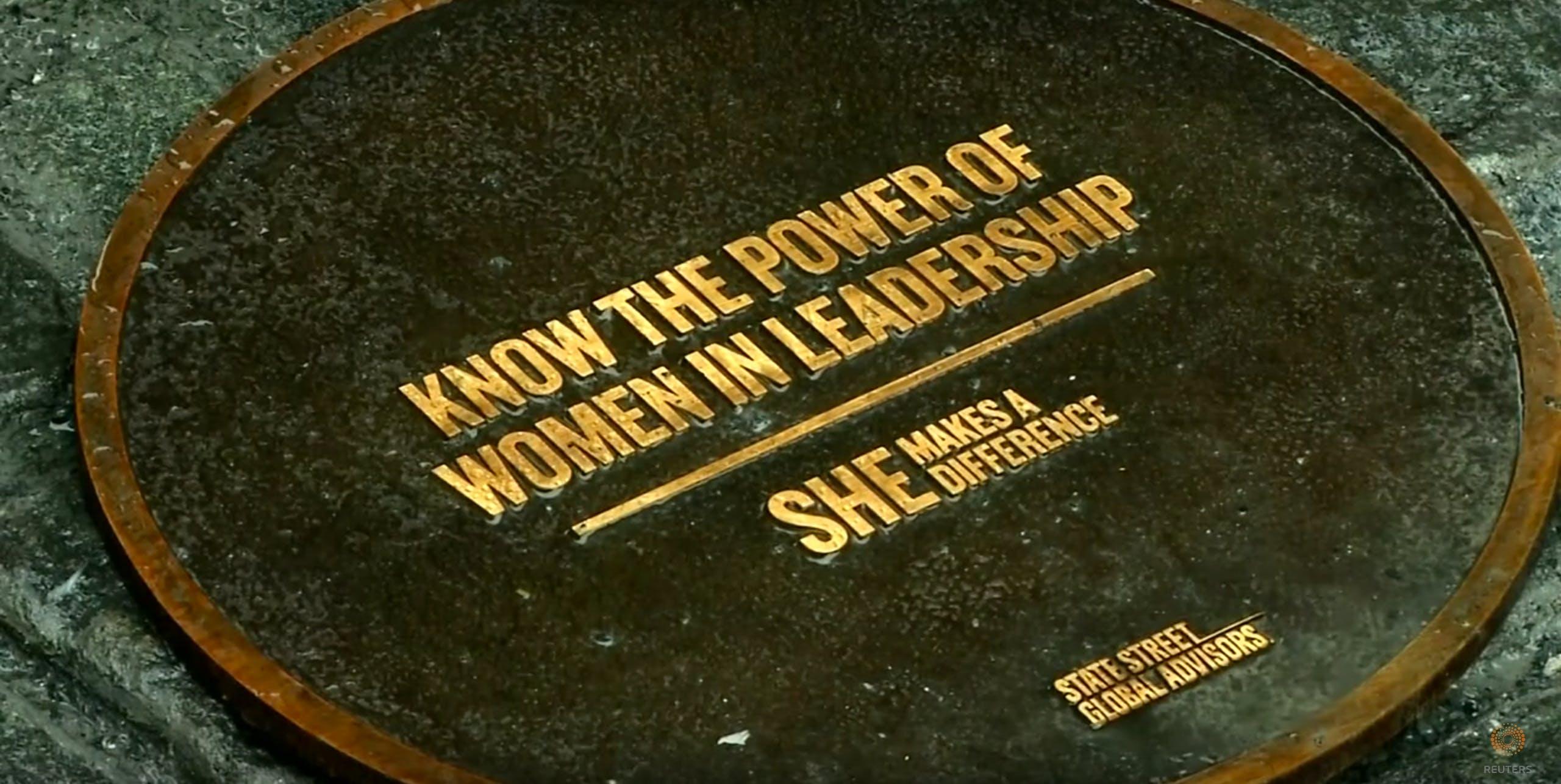 Wall Street statue plaque