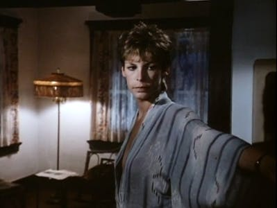 A woman stands in a robe in a scene from love letters