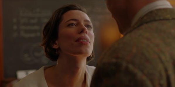 A scene from professor mastron and the wonder woman showing a woman gazing into the eyes of a man