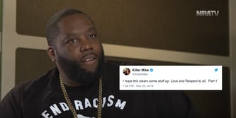 """Killer Mike sits in a black teeshirt that reads """"End Racism"""""""