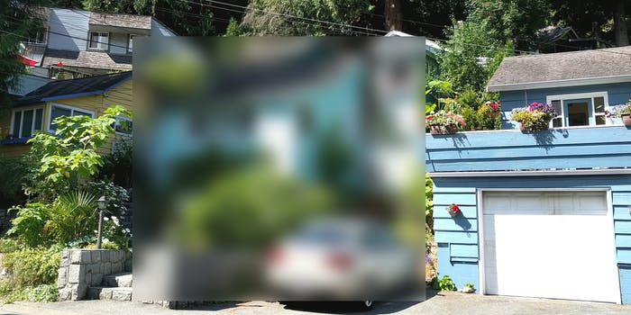 house and car blurred out of neighborhood