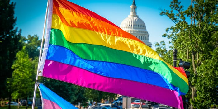 The LGBTQ flag flyig in front of the U.S. capitol building.