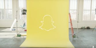 Snapchat ghost logo on yellow background