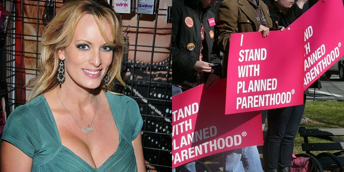 """Stormy Daniels next to protesters with signs that say """"I Stand With Planned Parenthood."""""""