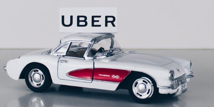 Uber logo above a toy car