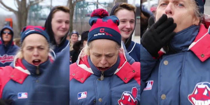 Chief Wahoo fans display racist insults mocking Native Americans at protesters against the Cleveland Indians.