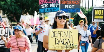 Protesters march for Dreamers after President Trump rescinds DACA.