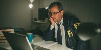 FBI agent looking at laptop