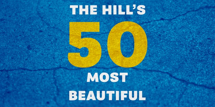 """""""The Hill's 50 Most Beautiful"""" over cracked concrete"""