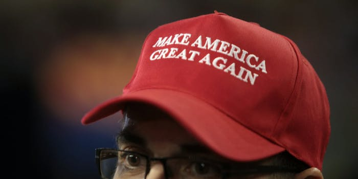 A man wearing a red 'Make America Great Again' hat.