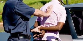Black man being placed under arrest