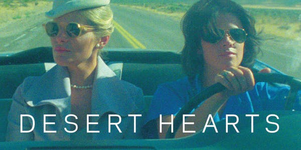 A scene from desert hearts showing two women driving in a car