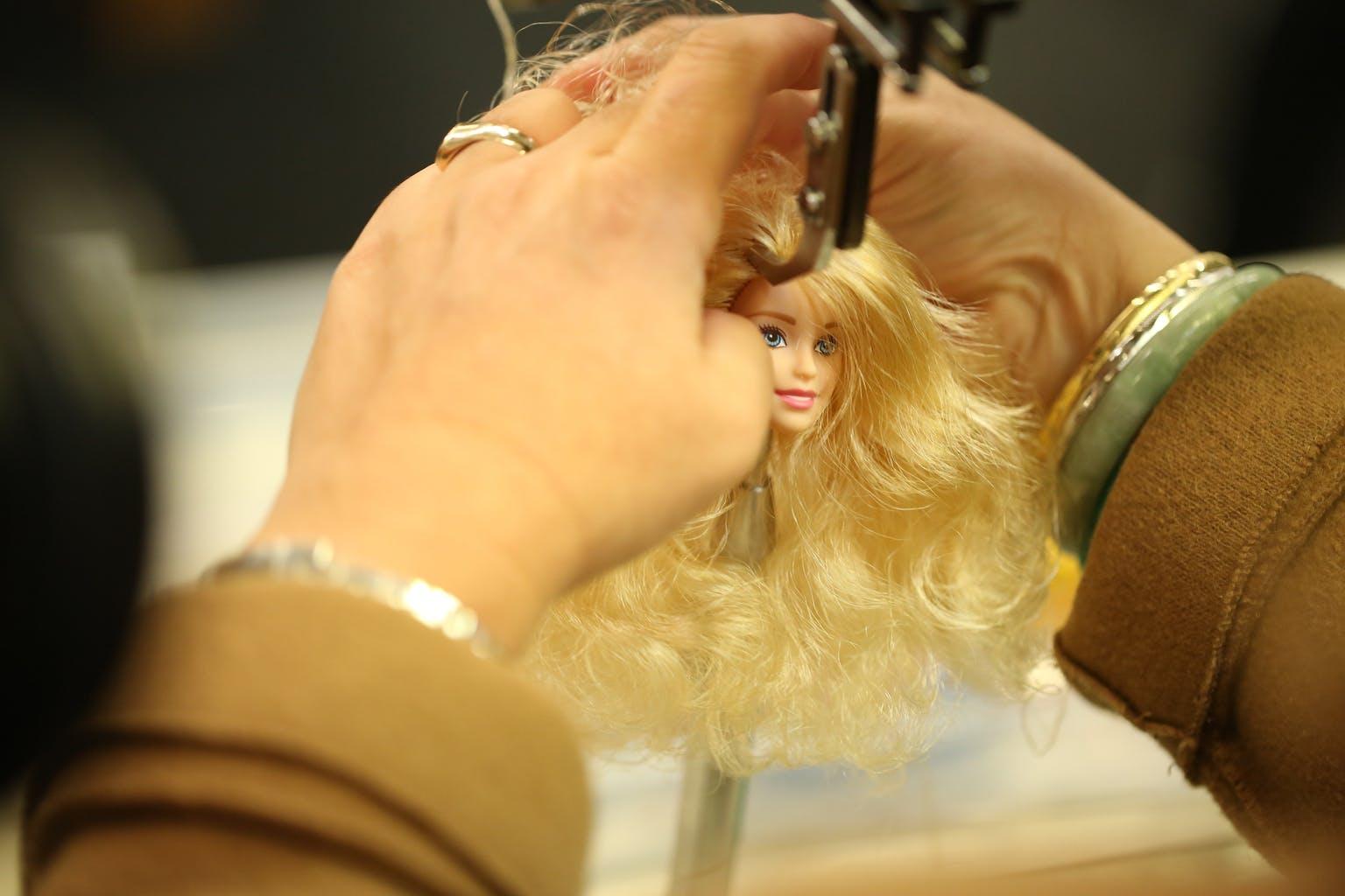 Tiny Shoulders: Rethinking Barbie barbie head