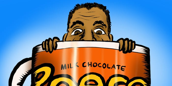 Ajit Pai Caricature behind a giant Reese's Pieces Mug