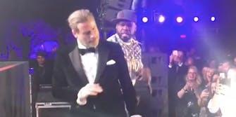 John Travolta dances onstage with 50 Cent