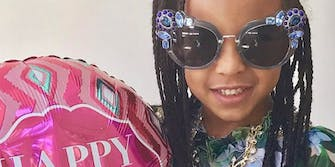 """Blue Ivy Carter holds a """"Happy Mother's Day"""" balloon"""