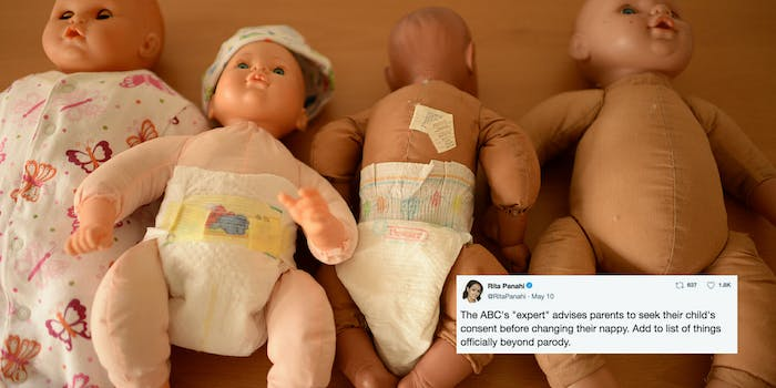 Baby dolls used for diaper changing with a tweet criticizing the concept of asking a baby for consent to change a diaper.
