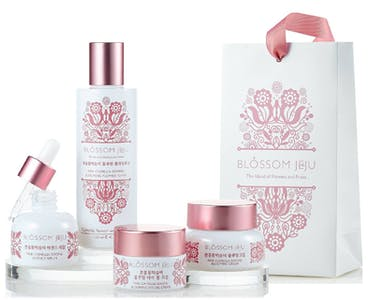 Korean brand Blossom Jeju packaging with beautiful pink flowers on white
