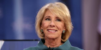 Education Secretary Betsy DeVos said guns in schools is not part of a federal school safety commission's charge when asked by a member of Congress on Tuesday afternoon.