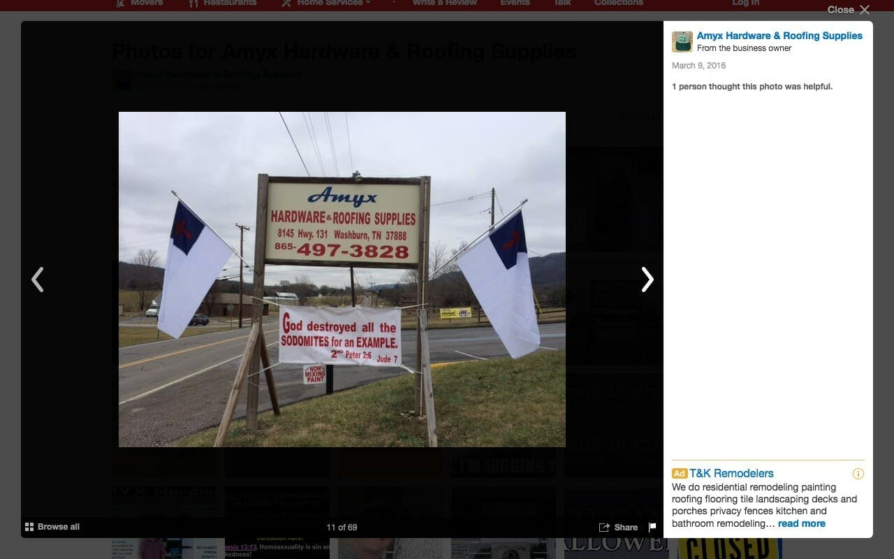 Jeff Amyx's his homophobic store sign with homophobic signage and Christian flags.