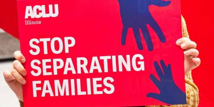 """Protester holding sign that reads """"Stop Separating Families"""""""