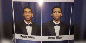 Twin brother takes class photo for both of them.