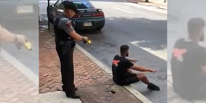 police taser man sitting on curb