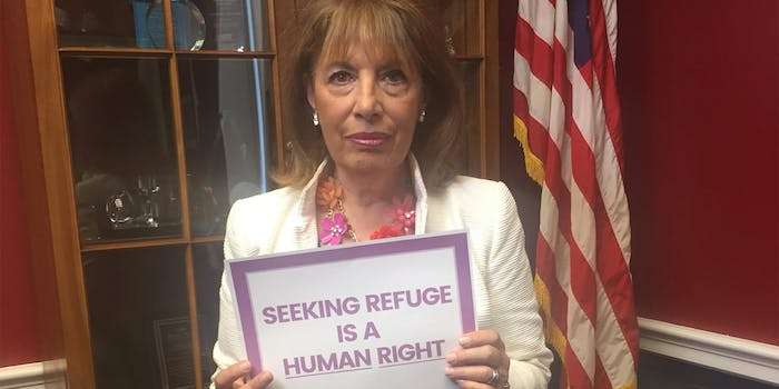 """Rep. Jackie Speier holding """"Seeking refuge is a human right"""" sign"""