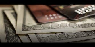 Hundred dollar bills and credit cards
